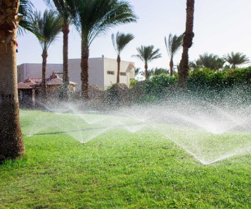 Irrigation system watering turf